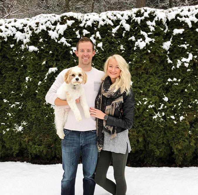 Drs. Nick and Whitney Forsythe standing outside with their dog